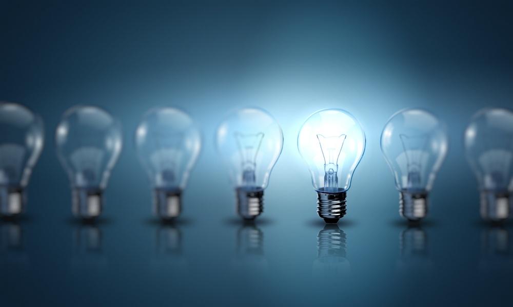 Light bulb lamps on a colour background.jpeg